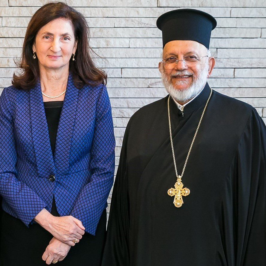 Mrs Amelia Katsogiannis Head of College with the Very Reverend Father S. Scoutas